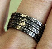 Stack of Bark Rings, worn and made by Julie A. Brown