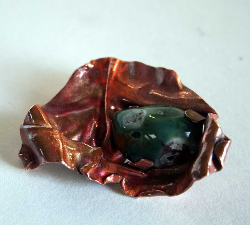 Earth Embrace - Fold formed copper and jasper brooch by Julie A. Brown