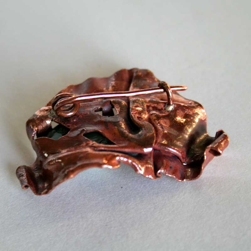 back view of Earth Embrace brooch showing handmade pin