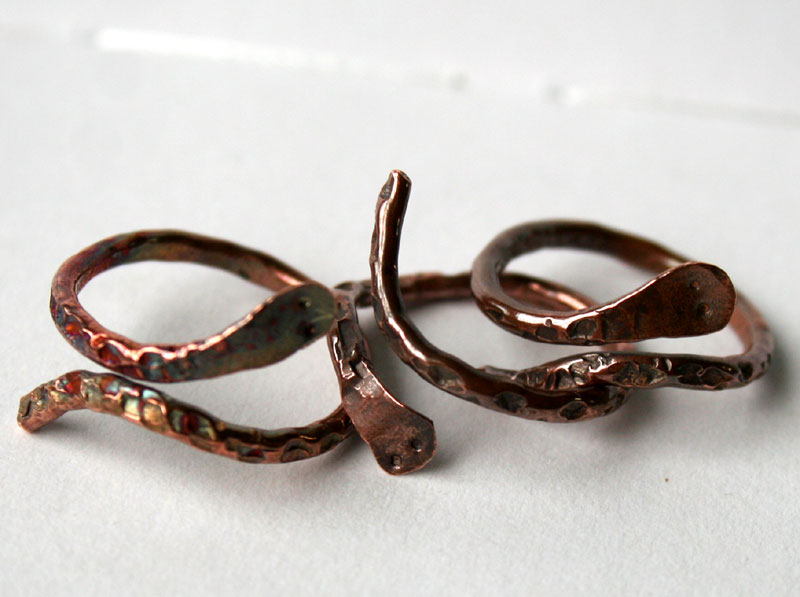 Group of Transformation adjustable copper serpent rings handcrafted by Julie A. Brown