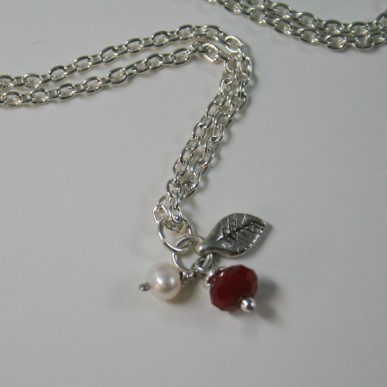 Berries - synthetic red jade, white freshwater pearl, metal leaf on sterling silver chain