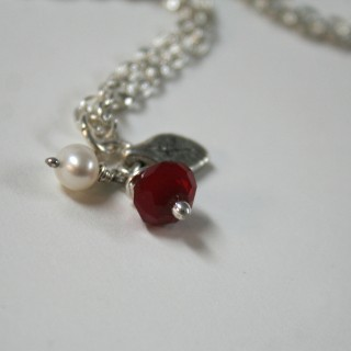 Berries - handcrafted necklace with red synthetic jade, and white freshwater pearl on sterling silver chain.