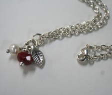 Red synthetic jade facetted bead and white freshwater pearl on Sterling Silver Chain